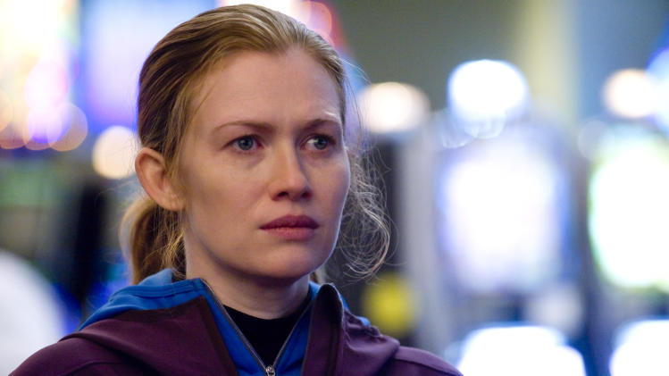 "In this publicity image released by AMC, Mireille Enos is shown in a scene from ""The Killing."" Netflix says it is reviving ""The Killing"" after its cancellation by AMC. A fourth and final season will be available to Netflix subscribers, the streaming service said Friday, Nov. 15, 2013. (AP Photo/AMC, Carole Segal)"