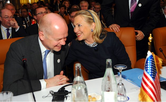 US Secretary of State Hillary Rodham Clinton sits next to British foreign minister William Hague, left, at the start of the Conference on Syria in Tunis, Tunisia, Friday Feb. 24, 2012. The birthplace 