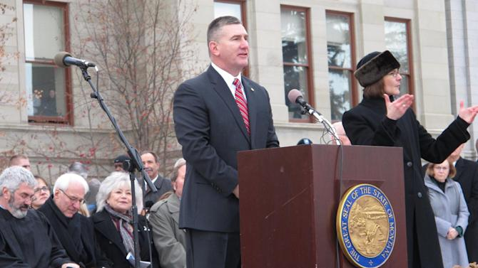 This Jan. 7, 2013 photo shows Montana Lt. Gov. John Walsh speaking after his inauguration in Helena, Mont. Walsh announced his candidacy Thursday Oct. 3, 2013 for the U.S. Senate seat being vacated by Max Baucus after next year. (AP Photo/Matt Volz)