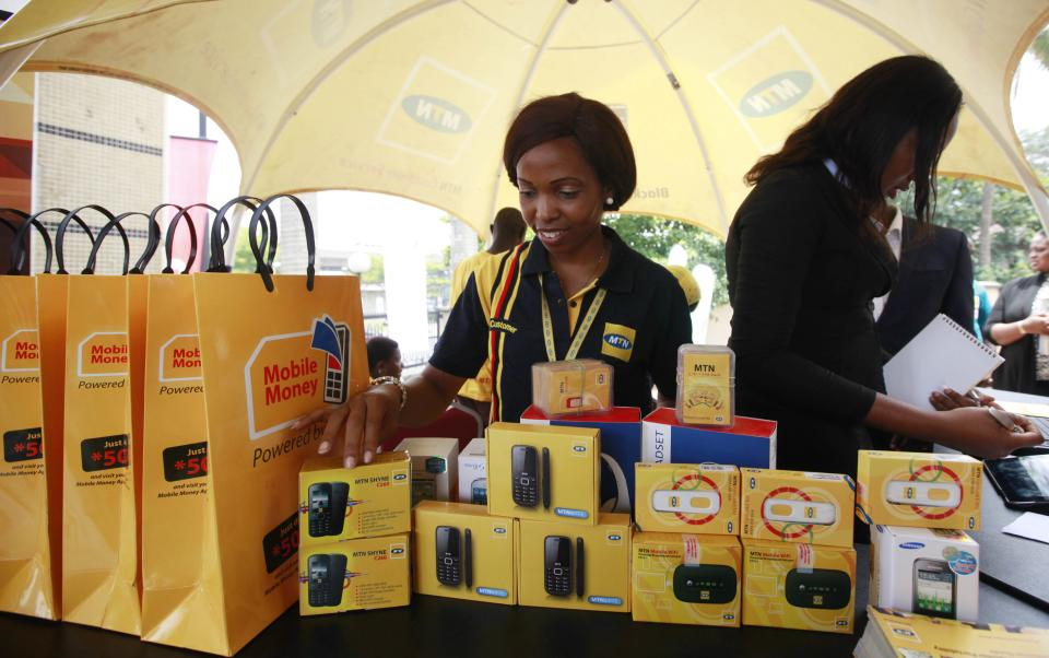 FILE- In this Monday April. 22, 2013 file photo, staff of MTN Nigeria workduring the launch of mobile number portability in Lagos, Nigeria. MTN Group ...