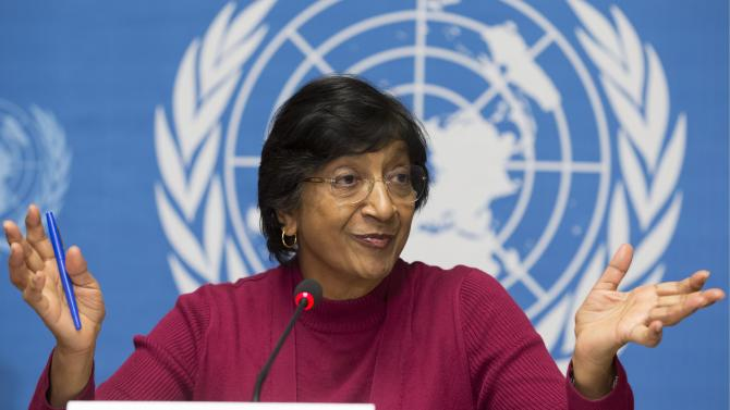 """UN High Commissioner for Human Rights, South African Navi Pillay speaks during a news conference at the European headquarters of the United Nations in Geneva, Switzerland, Monday, Dec. 2, 2013. The United Nations human rights chief says there is mounting evidence that Syrian government officials including President Bashar Assad are responsible for crimes against humanity and war crimes. Pillay says a U.N. panel investigating abuses in Syria's civil war has produced """"massive evidence"""" of crimes that """"indicates responsibility at the highest level of government, including the head of state."""" (AP Photo/Keystone, Salvatore Di Nolfi)"""