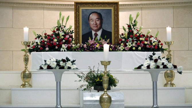 A photo of Rev. Sun Myung Moon rests inside a Unification Church in Seoul, South Korea, Tuesday, Sept. 4, 2012. Moon, the self-proclaimed messiah who founded the church, died Monday, Sept. 3, 2012, at a church-owned hospital near his home in Gapyeong County, northeast of Seoul, church officials said. He was 92. (AP Photo/Hye Soo Nah)