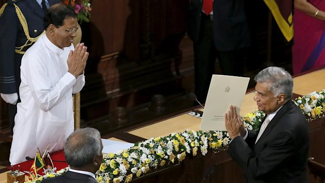 Sri Lanka's Prime Minister Wickremesinghe gestures after taking an oath as he is sworn in as minister of policy planning and economic affairs in front of Sri Lanka's President Sirisena in Colombo,