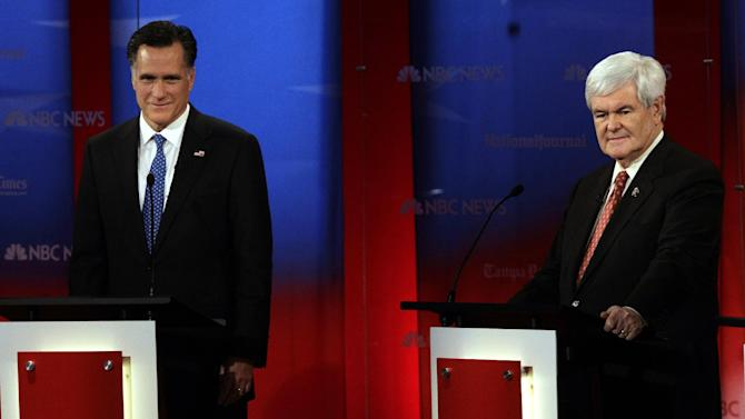 Republican presidential candidates, former Massachusetts Gov. Mitt Romney, left, stands next to former House Speaker Newt Gingrich before a Republican Presidential debate Monday Jan. 23, 2012, at the University of South Florida in Tampa, Fla. (AP Photo/Paul Sancya)