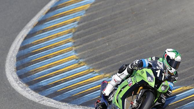 Kawasaki rider LeBlanc of France competes ahead of Honda rider Da Costa of France during the 38th Le Mans 24 Hours motorcycling endurance race in Le Mans
