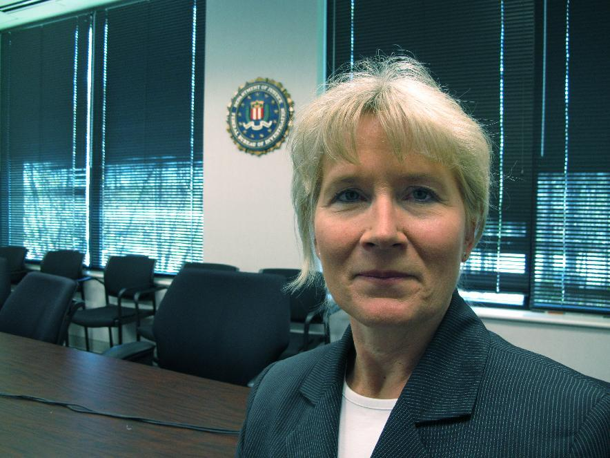 In this Monday, March 26, 2012 photo, Special Agent Joan Fleming stands in a conference room at the Federal Bureau of Investigation's office in Cary, N.C. In her 25 years with the FBI, Fleming has seen the amounts of money scammed from elderly victims rise to hundreds of thousands of dollars. (AP Photo/Allen Breed)