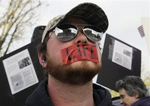 File photo of anti-abortion protester during legal arguments over the Patient Protection and Affordable Care Act in Washington