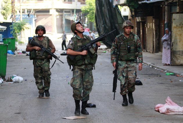 Lebanese army soldiers patrol the Sunni Muslim Bab al-Tebbaneh neighbourhood after being deployed to tighten security in Tripoli