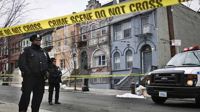 Police guard a sheet-covered plastic bag next to a police vehicle on Eagle Avenue in the Bronx borough of New York, Tuesday, Feb. 26, 2013. A man out walking his dog early Tuesday morning discovered the dismembered remains of a woman in heavy duty plastic garbage bags, police said. The body is believed to be that of a 45-year-old woman. Her name was not immediately released, and the medical examiner's office was working to determine a cause of death.  (AP Photo/Bebeto Matthews)