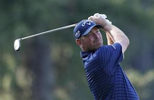 Denmark's Thomas Bjorn tees off on the 11th hole during the first round of the 2013 PGA Championship golf tournament at Oak Hill Country Club in Rochester