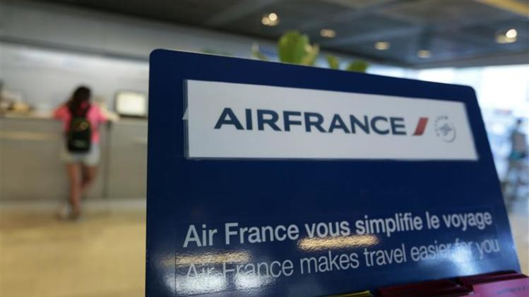 Passengers check-in at an Air France counter in Nice International airport in Nice