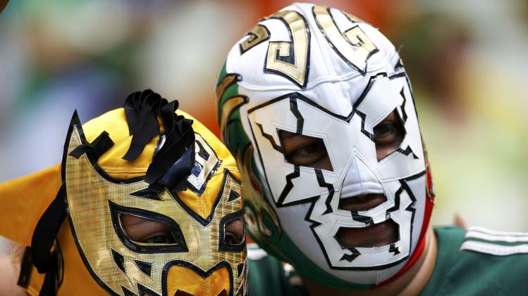 Fans of Mexico wearing Mexican lucha libre wrestling masks are pictured before their 2014 World Cup round of 16 game against the Netherlands at the Castelao arena in Fortaleza