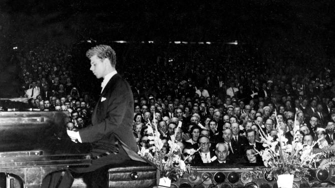 FILE - This Feb. 19, 1959 file photo shows pianist Van Cliburn performing for the American Association of School Administrators at the Convention Hall in Atlantic, City, N.J.  Cliburn, the internationally celebrated pianist whose triumph at a 1958 Moscow competition helped thaw the Cold War and launched a spectacular career that made him the rare classical musician to enjoy rock star status  died early Wednesday, Feb. 27, 2013, at his Fort Worth home following a battle with bone cancer.  He was 78. (AP Photo, file)