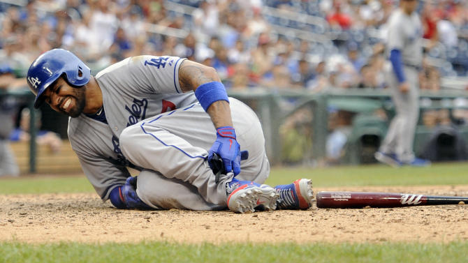 Los Angeles Dodgers' fielder Matt Kemp reacts after being hurt and called out against the Washington Nationals during the ninth inning of a baseball game on Sunday, July 21, 2013, in Washington. The Dodgers won 9-2. (AP Photo/Nick Wass)