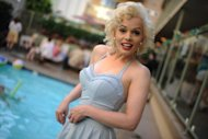 Memory Monroe, a Dutch-born Marilyn lookalike, at the Immortal Marilyn Pool Party at the Hollywood Orchid Suites hotel in California on August 2. Decked out in a single-piece light blue swimsuit, she flashed sultry smiles in a perfect Marilyn imitation