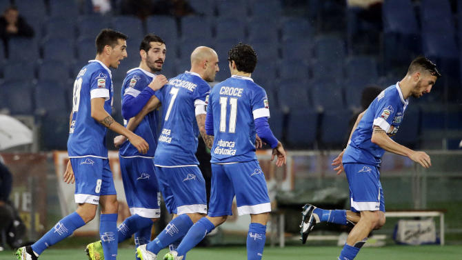 Empoli's Massimo Maccarone, center, celebrates with his teammates after he scored on a penalty kick during a Serie A soccer match between Roma and Empoli, at Rome's Olympic Stadium, Saturday, Jan. 31, 2015. (AP Photo/Andrew Medichini)
