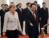 Chinese Premier Wen Jiabao (R) and German Chancellor Angela Merkel attend a welcoming ceremony at the Great Hall of the People in Beijing on August 30. Merkel is holding top-level talks on her second visit to China this year, with Europe&#39;s debt crisis taking centre stage as it begins to drag on the two global powers