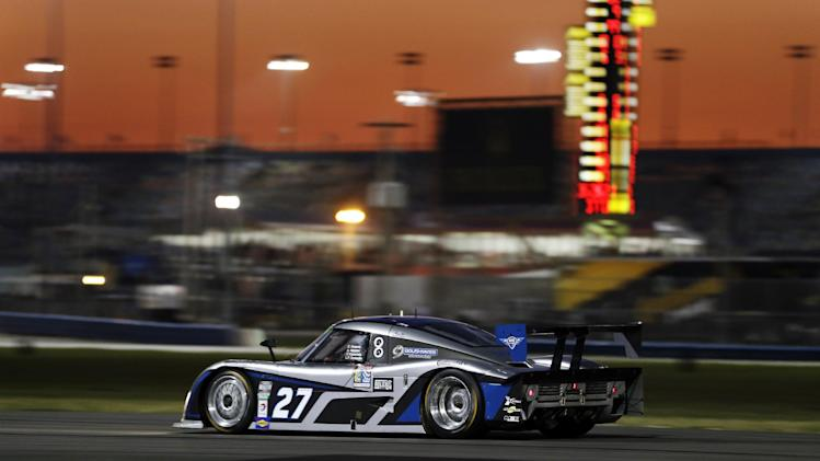 Emmanuel Anassis, of Canada, drives the BTE Sport Ford Riley through the infield course during the Grand-Am Series Rolex 24 hour auto race at Daytona International Speedway, Saturday, Jan. 26, 2013, in Daytona Beach, Fla. (AP Photo/John Raoux)