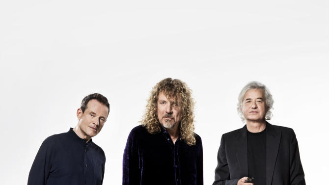 """This undated handout photo provided by the Warner Music Group shows members of Led Zepplin, from left, John Paul Jones, Robert Plant and Jimmy Page. Led Zeppelin is coming to a movie theater near you. Then a record store. The iconic British rock 'n' roll band will release its 2007 """"Celebration Day"""" reunion as a concert film on Oct. 13, then will put out the show on multiple video and audio formats on Nov. 19. (AP Photo/Warner Music Group, Soren Solkaer Starbird)"""