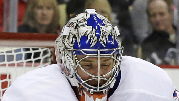 New York Islanders goalie Evgeni Nabokov (20) blocks a shot during the second period of an NHL hockey game against the Pittsburgh Penguins in Pittsburgh, Saturday, March 30, 2013. (AP Photo/Gene J. Puskar)