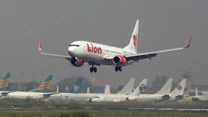 In this May 12, 2012 photo, a Lion Air passenger jet takes off from Juanda International Airport in Surabaya, Indonesia. Dozens of fledgling airlines that have sprung up to serve Indonesia's island-hopping new middle class could jeopardize the archipelago's recently improved safety reputation, aviation experts say. (AP Photo/Trisnadi)