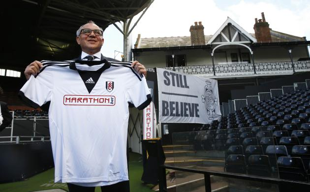 New Fulham manager Felix Magath poses for photographers at Craven Cottage in London