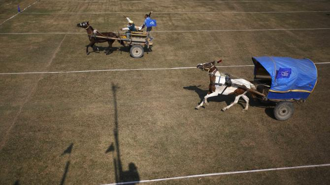 Horse carts race to the finishing line during the Elephant festival at Sauraha in Chitwan