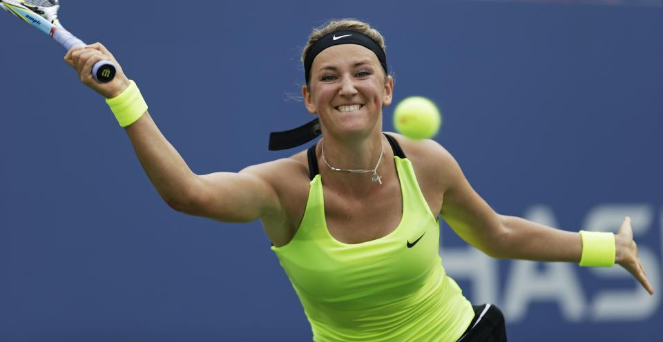 Victoria Azarenka, of Belarus, returns a shot to Samantha Stosur, of Australia, in the quarterfinals of the 2012 US Open tennis tournament, Tuesday, Sept. 4, 2012, in New York. Azarenka won the match. (AP Photo/Kathy Willens)