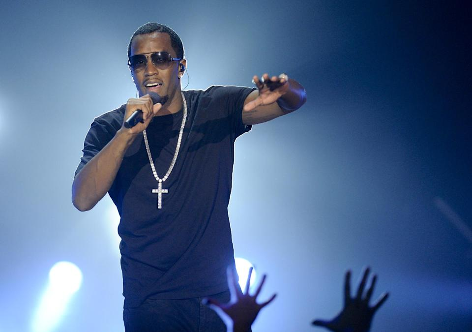 "Hip-hop entrepreneur Sean ""P. Diddy"" Combs performs at Caesars Entertainment ""Escape to Total Rewards"" kick-off at Gotham Hall on Thursday, March 1, 2012 in New York. (AP Photo/Evan Agostini)"