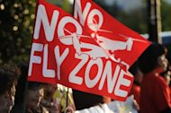 "Protesters display ""No fly zone"" flags rally against US military bases in Okinawa, in Tokyo on October 24. A US soldier has allegedly attacked a schoolboy on an island already angry with the US military presence"