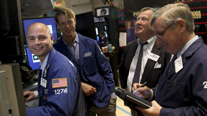 Traders work on the floor at the New York Stock Exchange in New York, Wednesday, Oct. 31, 2012.  Traffic is snarled, subways out of commission, streets flooded and power out in many parts of the city, but the New York Stock Exchange opened without hitch Wednesday after an historic two-day shutdown, courtesy of SuperstormSandy.  (AP Photo/Seth Wenig)