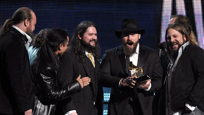 "Zac Brown, center, of the musical group Zac Brown Band accepts the award for best country album ""Uncaged"" at the 55th annual Grammy Awards on Sunday, Feb. 10, 2013, in Los Angeles. (Photo by John Shearer/Invision/AP)"