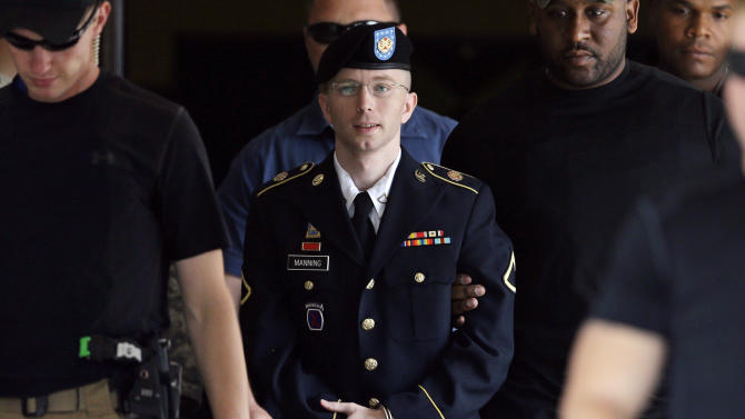 In this July 30, 2013 photo, Army Pfc. Bradley Manning is escorted out of a courthouse in Fort Meade, Md. Few Americans in living memory have emerged from obscurity to become such polarizing public figures _ admired by many around the world, fiercely denigrated by many in his homeland. (AP Photo/Patrick Semansky)