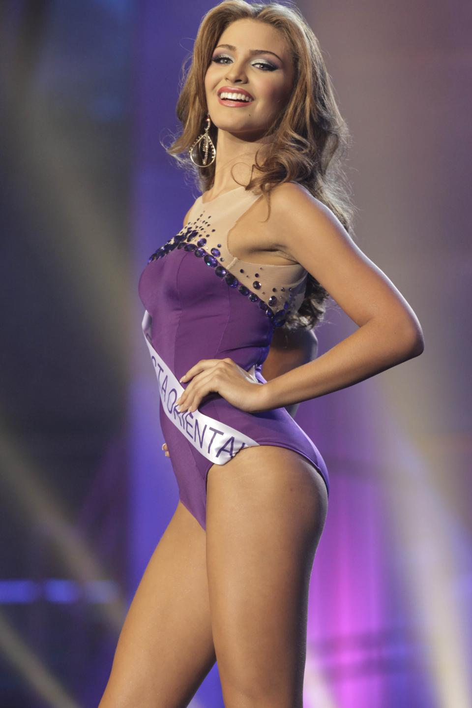 Miss Costa Oriente, Migbelis Castellanos poses during the Miss Venezuela 2013 beauty pageant in Caracas, Venezuela, Thursday, Oct. 10, 2013. (AP Photo/Ariana Cubillos)