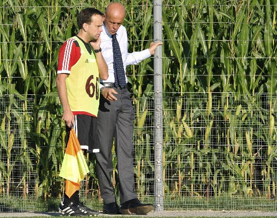 In this Wednesday Sept. 4, 2013 image made available from UEFA, chief refereeing officer for UEFA Pierluigi Collina, right, gives an explanation to assistant referee Kim Thomas Haglund from Norway dur