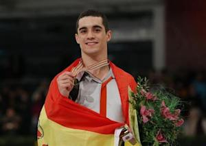 Gold medallist Fernandez of Spain poses with medal after the Men Free Skating at the ISU European Figure Skating Championships in Budapest