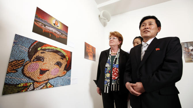 Associated Press Senior Vice President and Executive Editor Kathleen Carroll, left, and Korean Central News Agency Senior Vice President Kim Chang Gwang tour the gallery during an opening reception for the Window on North Korea: Photographs from the DPRK photo exhibit, Thursday, March 15, 2012, in New York.  The exhibit, which marks 100 years since the birth of former North Korean leader Kim Il Sung, is a joint exhibition by The Associated Press and the Korean Central News Agency. (AP Photo/Jason DeCrow)