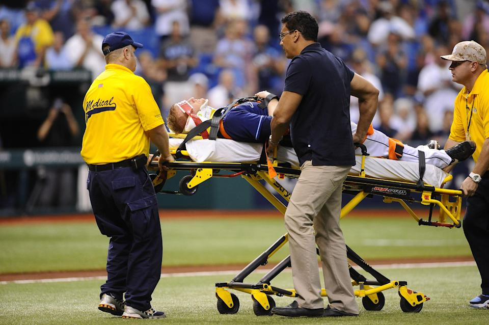 Tampa Bay Rays starting pitcher Alex Cobb lies on a stretcher as he is taken off the field by medical personnel after being hit by a line drive by Kansas City Royals' Eric Hosmer during the fifth inning of a baseball game Saturday, June 15, 2013, in St. Petersburg, Fla. (AP Photo/Brian Blanco)