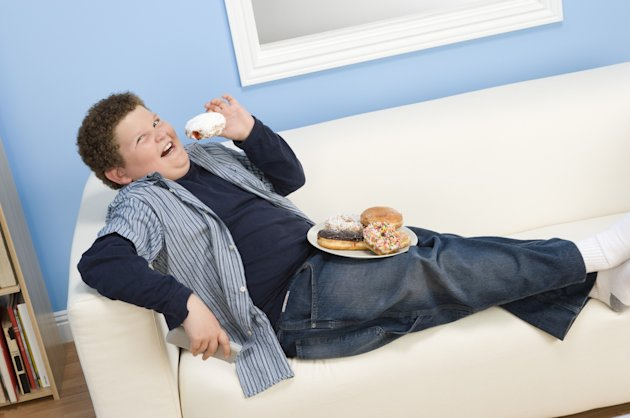 Having gadgets such as televisions and games consoles in the bedroom leads to obesity, experts warn (Image: Rex)