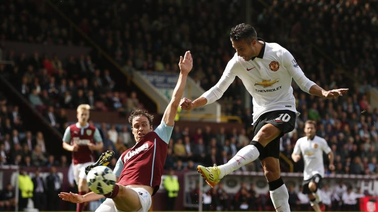 Manchester United's Van Persie is challenged by Burnley's Duff during their English Premier League soccer match at Turf Moor in Burnley