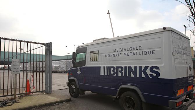 An armored truck of Brinks Diamond & Jewelry Services arrives at the cargo section of Brussels international airport, Tuesday, Feb. 19, 2013.  Police on Tuesday are looking for eight men who made a hole in a security fence of Brussels' international airport, drove onto the tarmac and robbed tens of millions of dollars worth of diamonds from the hold of a Swiss-bound plane. (AP Photo/Yves Logghe)