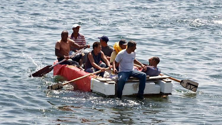 Seven Cubans in a homemade boat moments before being arrested by Cuban military agents after their attempt to escape from the island nation was thwarted by the sea currents, on June 4, 2009 in Havana
