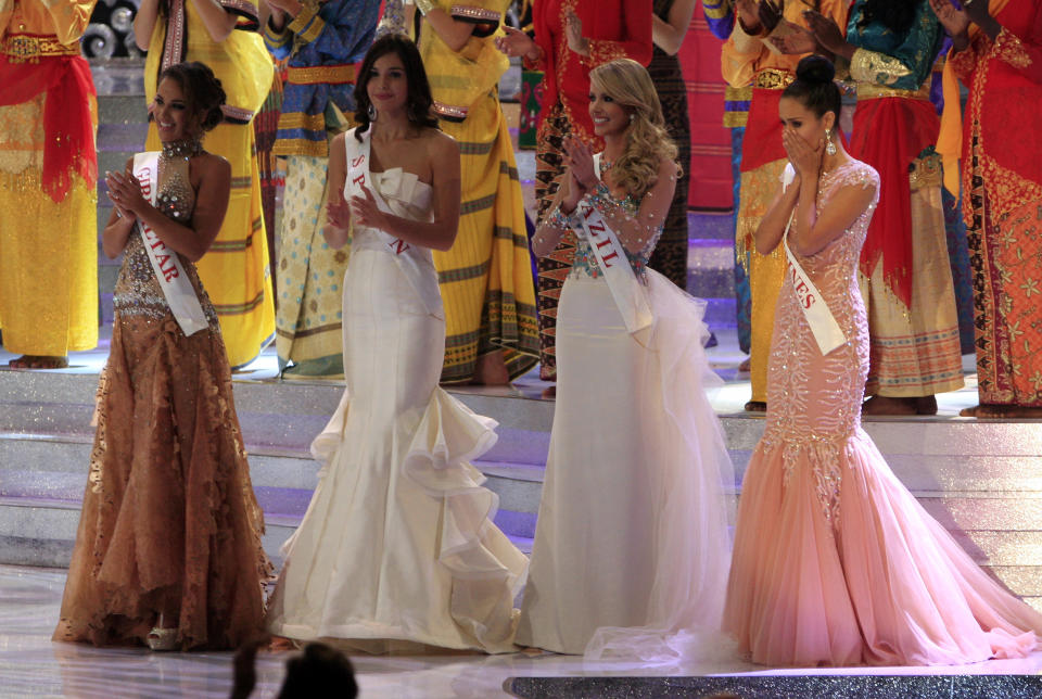 Miss Philippine Megan Young, right, reacts after winning the Miss World pageant final in Nusa Dua, Bali, Indonesia, Saturday, Sept. 28, 2013. (AP Photo/Firdia Lisnawati)