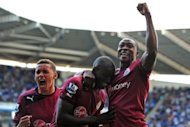 Newcastle's Demba Ba (C) celebrates with teammates Shola Ameobi (R) and James Tavernier during their Premier League match against Reading on September 29. The Magpies will be hoping to close down a Bordeaux attack that notched up four goals in their opener against Club Bruges