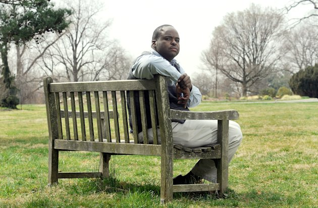 Robert Collins of Baltimore poses for a photo Friday, March 16, 2012 at Cylburn Arboretum in Baltimore. When Collins returned from a leave of absence from his job as a security guard with the Maryland Department of Public Safety and Correctional Services in 2010, he was asked for his Facebook login and password during a reinstatement interview, purportedly so the agency could check for any gang affiliations. (AP Photo/Steve Ruark)