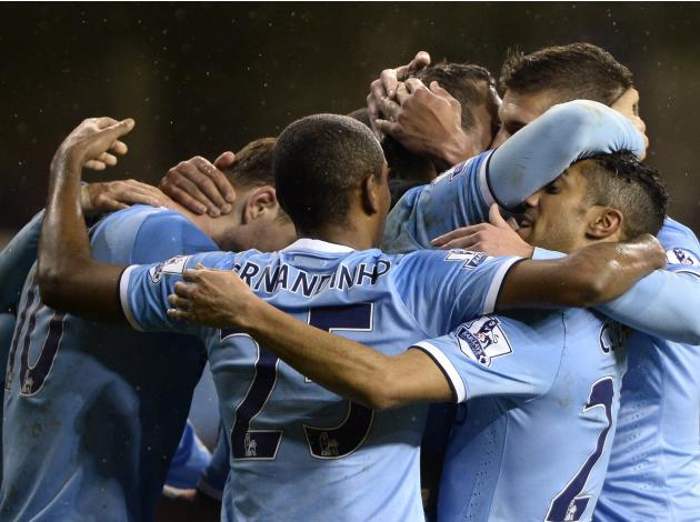 Manchester City players celebrate with Jovetic after he scored a goal against Tottenham Hotspur during their English Premier League soccer match at White Hart Lane in London