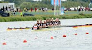 The German team of Women's Eight compete in the eight women of the rowing event during the London 2012 Olympic Games, at Eton Dorney Rowing Centre in Eton, west of London, on July 29, 2012.   AFP PHOTO / FRANCISCO LEONG