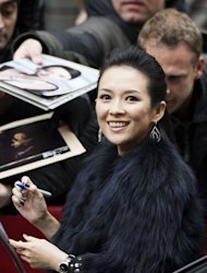Chinese actress Zhang Ziyi gives autographs to her fans as she arrives for a photocall and a press conference for the film Yi dai zong shi (The Grandmaster) in Berlin, February 7, 2013. The 63rd Berlin film festival opens with a gala screening of Chinese director Wong Kar Wai&#39;s martial arts epic about the mentor of kung fu superstar Bruce Lee