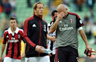 AC Milan&#39;s goalkeeper Christian Abbiati (R) reacts next to AC Milan&#39;s midfielder and captain Massimo Ambrosini (2nd L) at the end of their Serie A football match against Udinese at the Friuli stadium in Udine. Udinese won 2-1