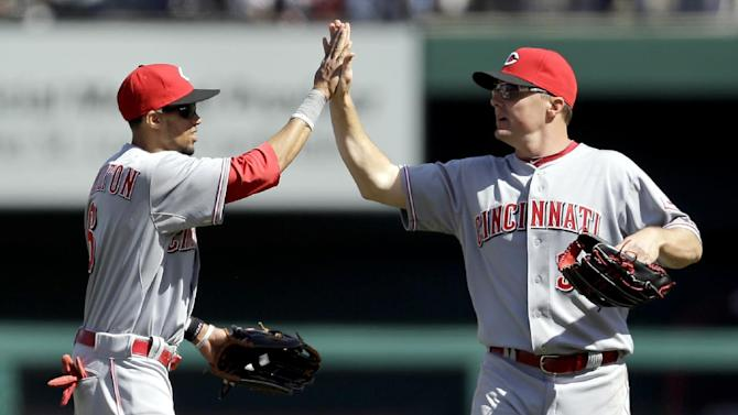 Cincinnati Reds' Billy Hamilton, left, and teammate Jay Bruce celebrate following a 4-0 victory over the St. Louis Cardinals in a baseball game on Wednesday, April 9, 2014, in St. Louis